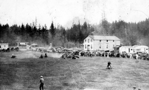 1930s motorcycle-soccer game at Franklin (Knights of Pythias Hall is the large building).