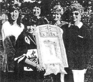 Five Lazor granddaughters proudly display the wedding photo that is encircled with Veronica's wedding veil. It is encased in a frame hand-carved by the stepfather of Julia (Junevitch) Palmer. Sharing stories of their heritage were (back row) Carol Hudson, Vince's daughter; Mary Jo Anderson, Mary's daughter; Barbara Lazor, John's daughter; and Nancy George, Vince's daughter. In front, Joan Mansfield, Mike's daughter.